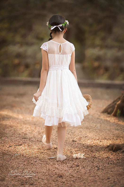 Girl in white is walking in the forest