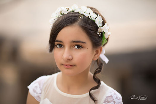 Girl in white dress with white tiara