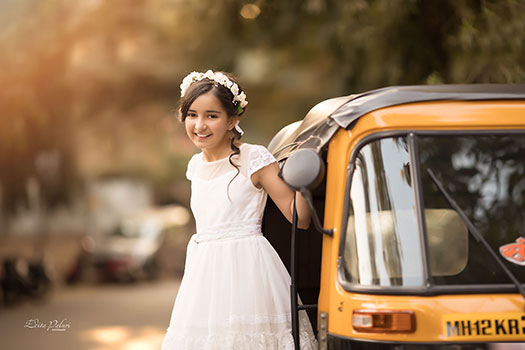 Girl in white dress in auto riksha in India