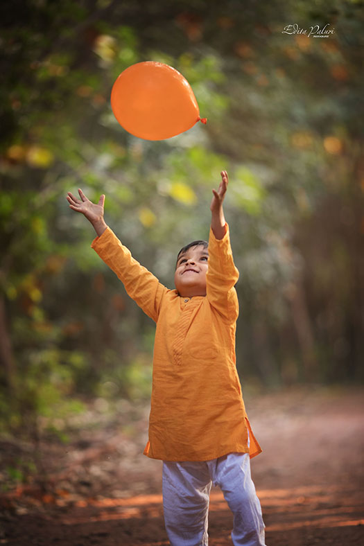 Boy with orange balloon