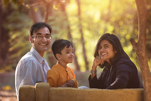 Family picture on bench in forest, Pune