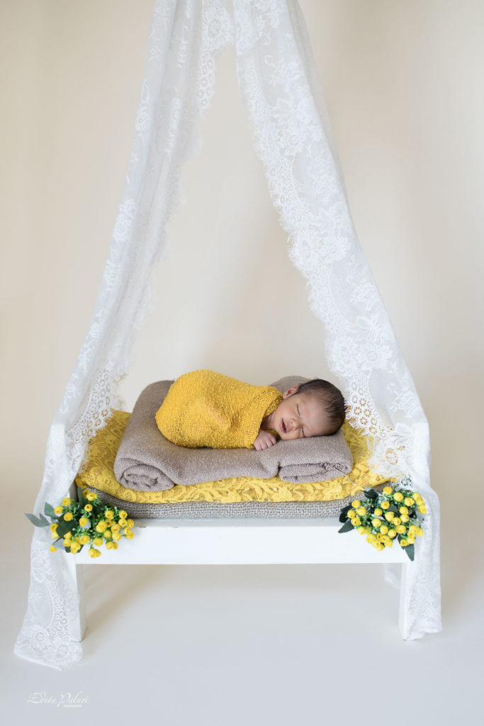 Baby photo shoot on small bed