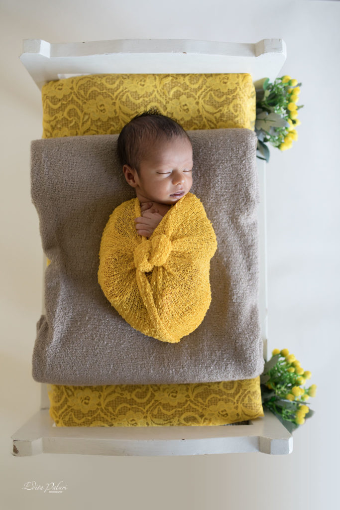 Indian baby boy in yellow wrap