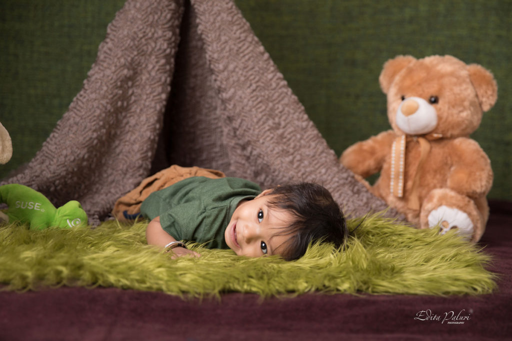 baby boy having rest near teepee Pune