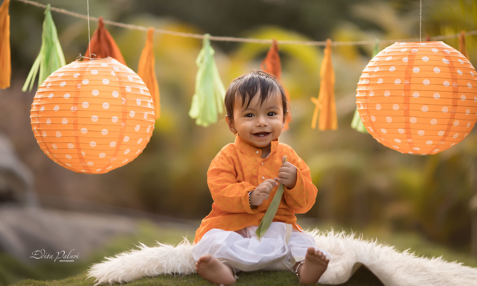 Indian baby boy in orange traditional attire