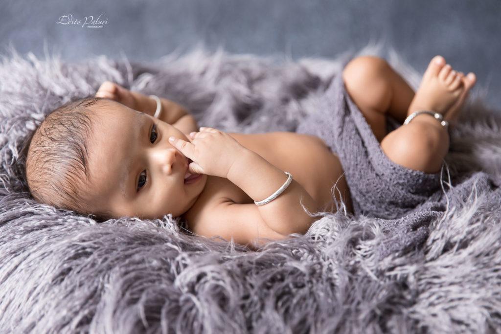 baby shoot on grey fur