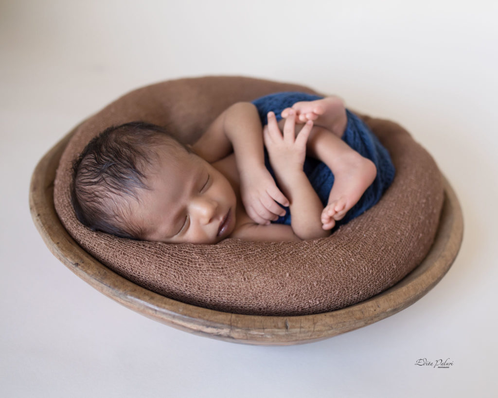 baby boy 14 days sleeping in basket
