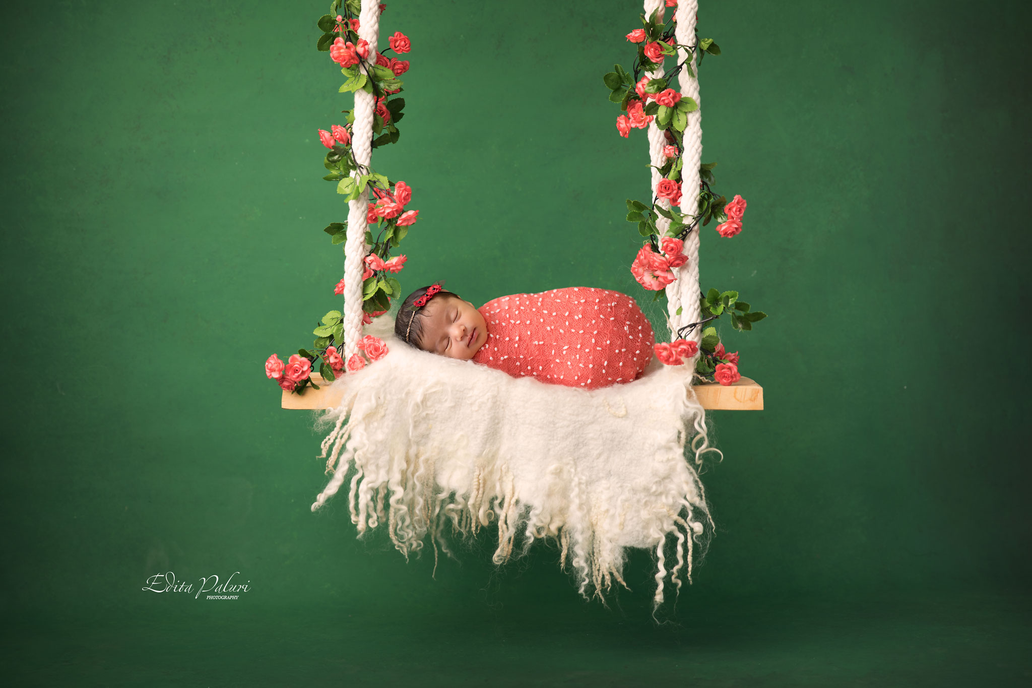 Newborn baby girl on swings picture
