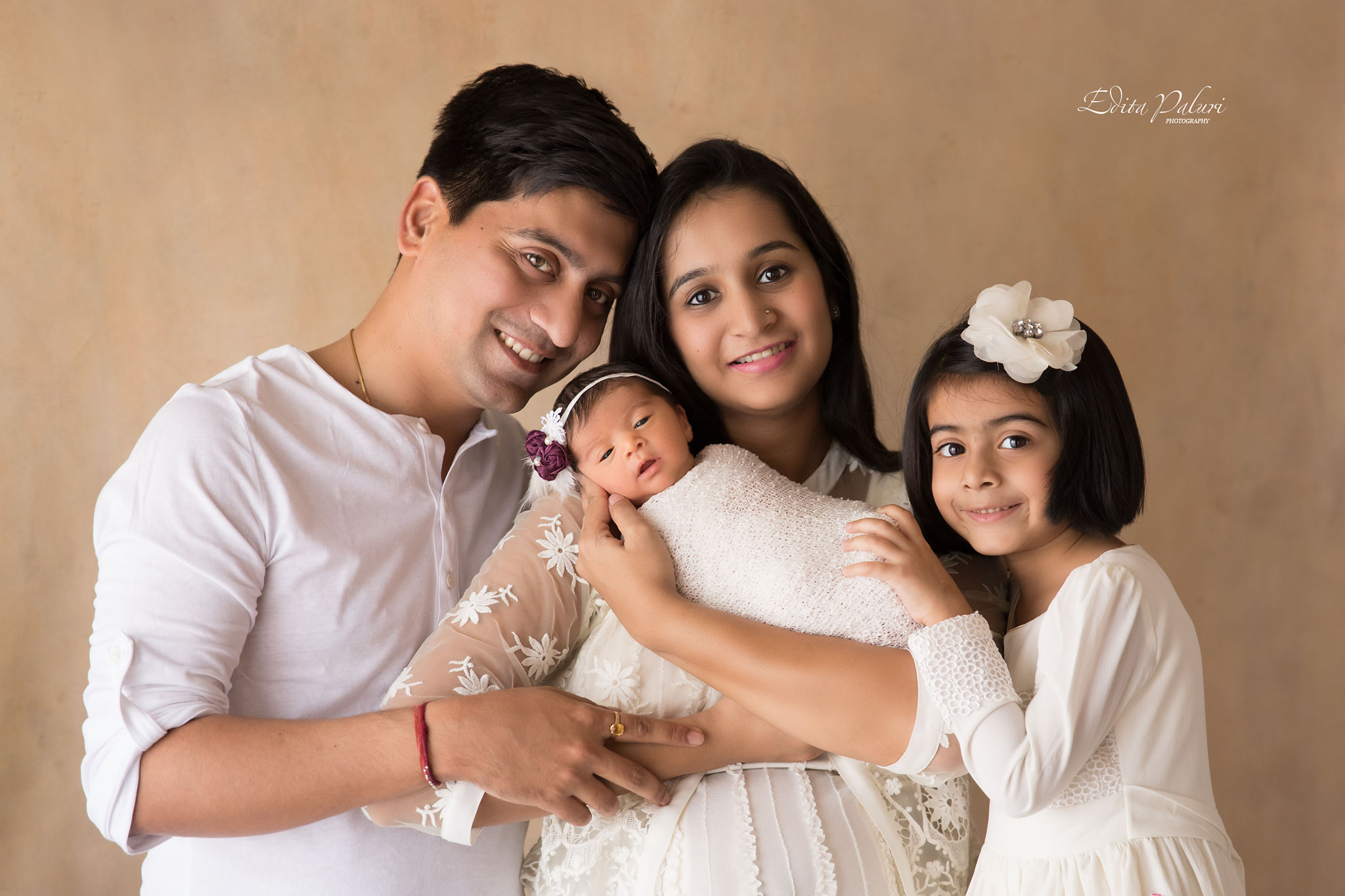 Family picture of 4, newborn girl
