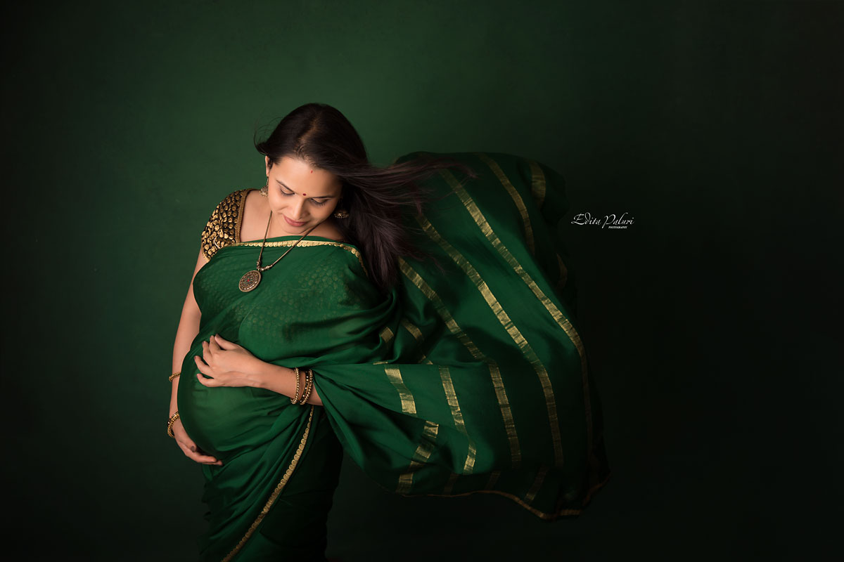 pregnancy picture in indian attire green sari