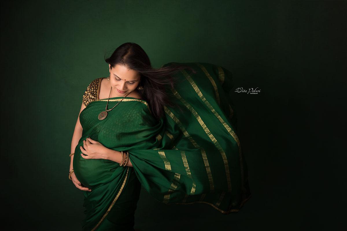 pregnancy picture in indian attire green sari