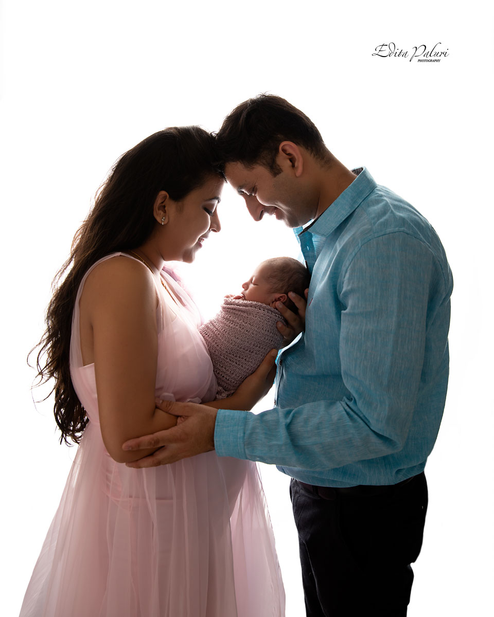 family with newborn backlit picture
