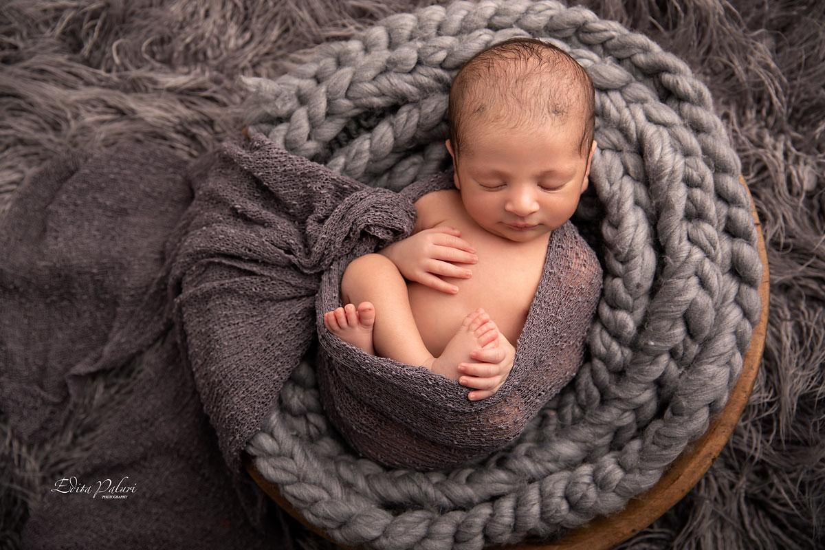 newborn boy in basket picture