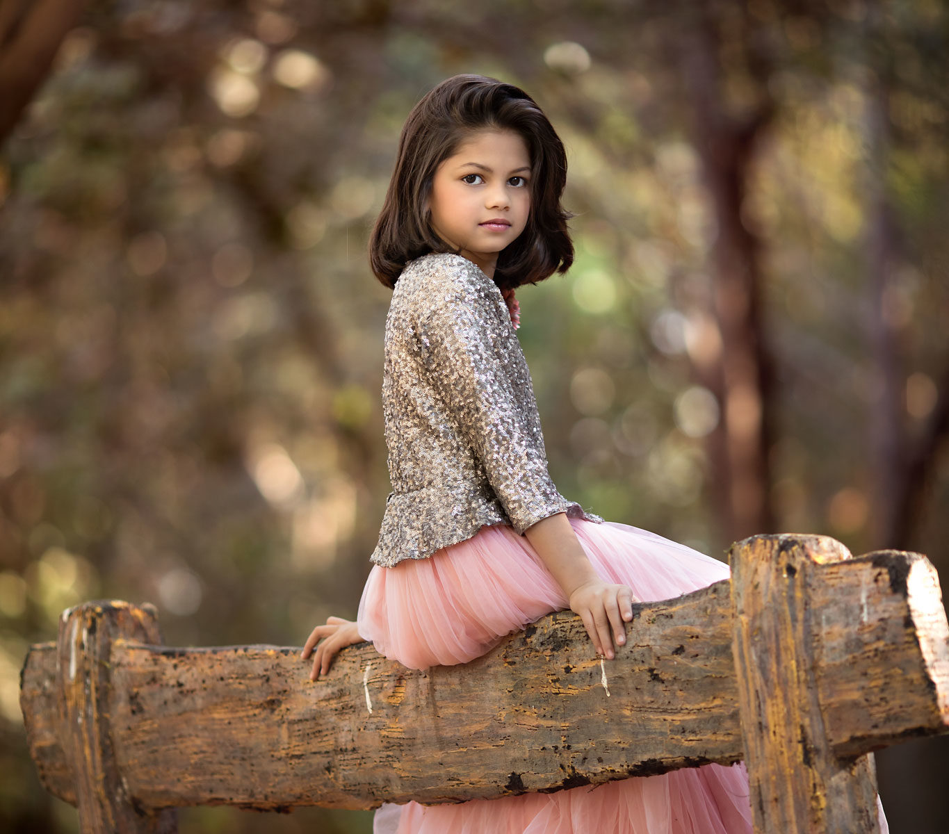Beautiful girl sitting on bench in the forest