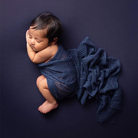 Newborn girl in blue Pune