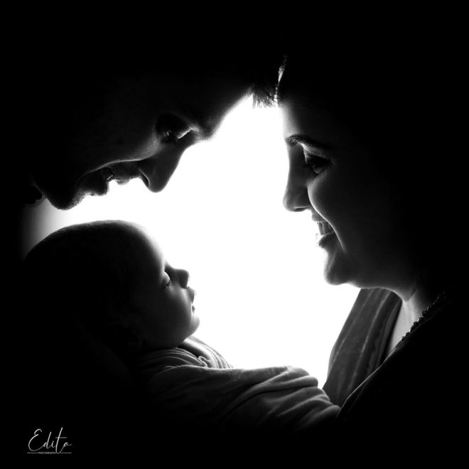 family silhouette with newborn baby girl