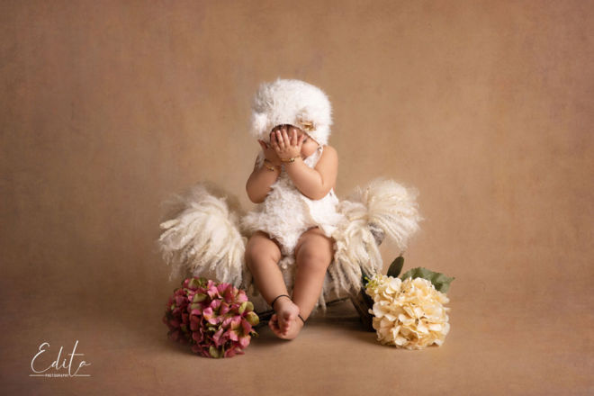 Creative baby shoot photography peek-a-boo at photo studio in Pune