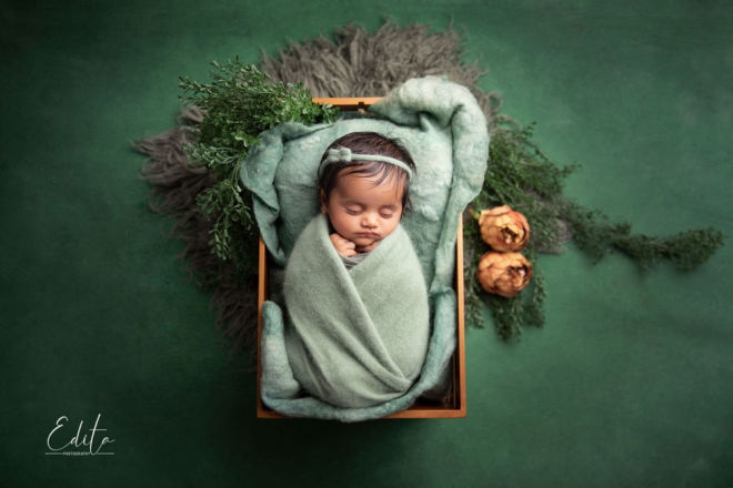 2 month Baby girl in green setup in photo studio in Pune
