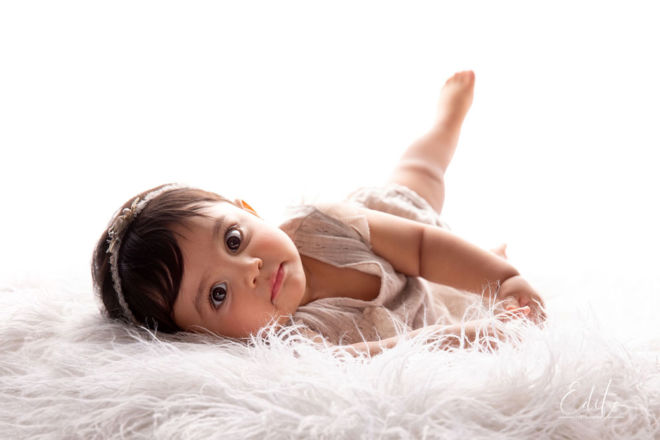 About Edita - Backlit 9 month baby girl photo in Pune