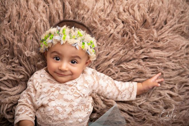 indian smiling baby girl photo shoot on brown flokati in Pune