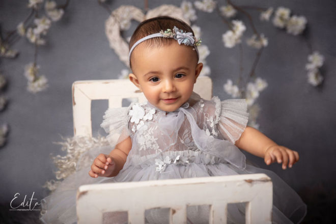 creative indian baby photo shoot ideas - girl sitting on mini bed