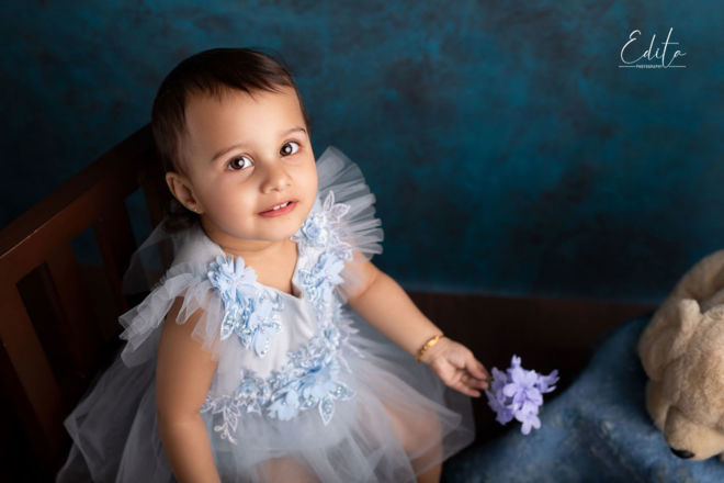 14 month old baby girl with blue dress photo in studio Pune