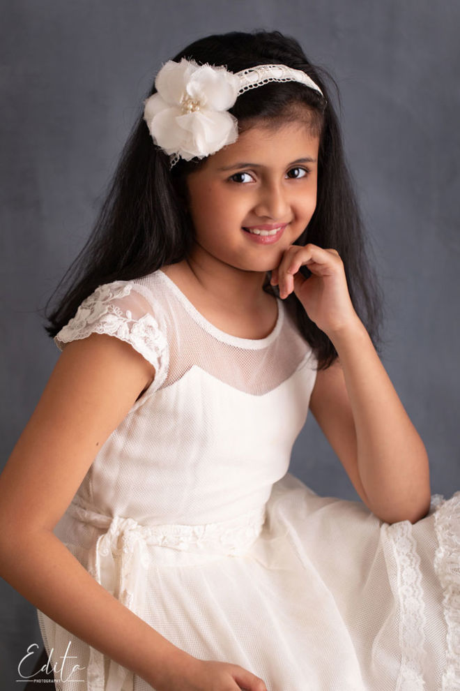 Children photo shoot - girl in white dress on grey canvas background Fine art photo in studio in Pune