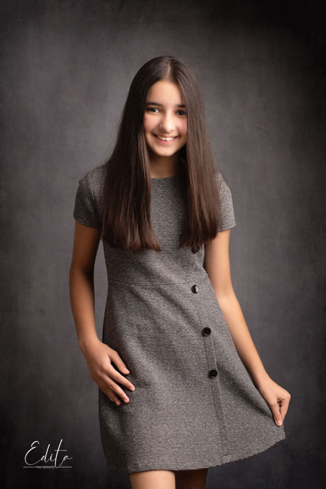children photo shoot - Graceful clicks macro photographer Anika photo in grey dress and dark grey background