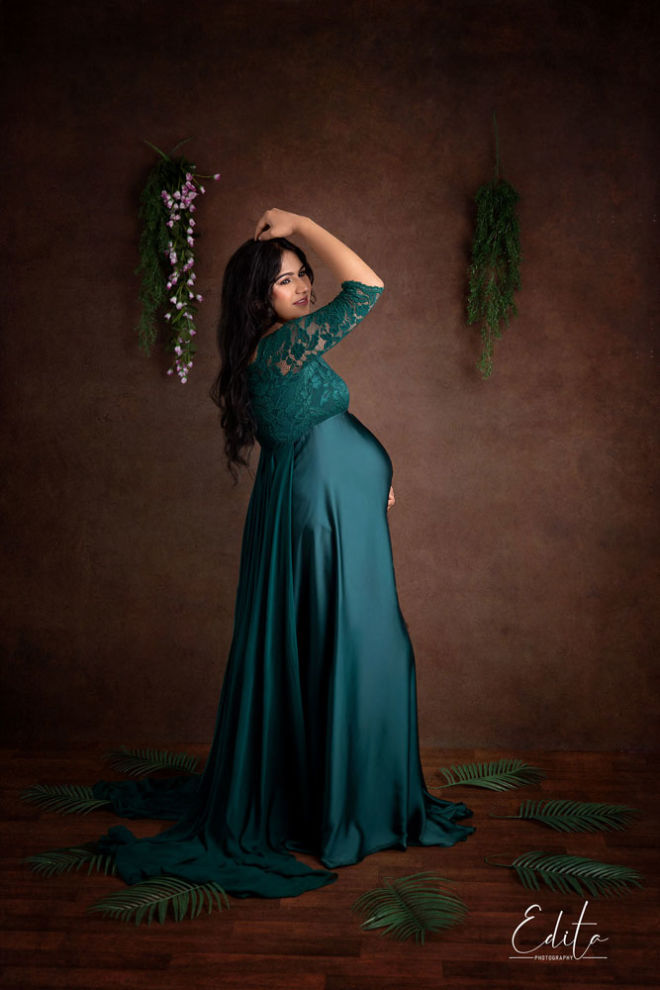Expecting mother in green lace designer gown on brown hand painted canvas fine art photo