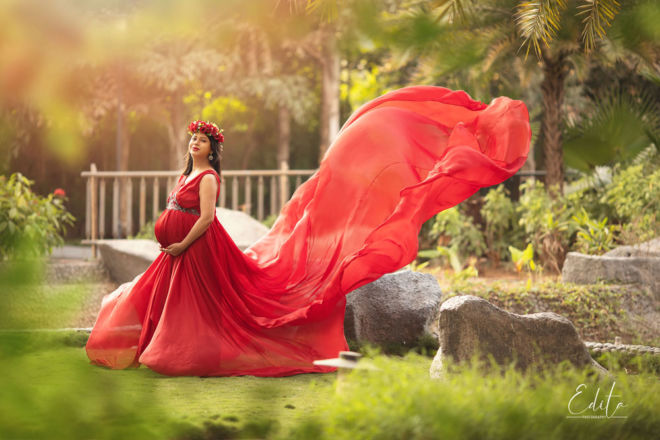 Maternity photoshoot in red flying gown
