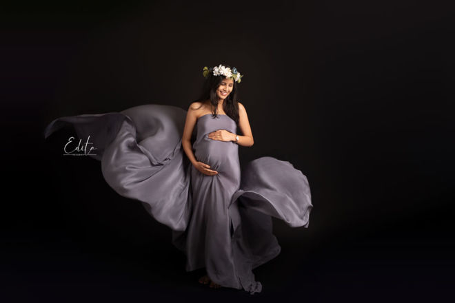 Fine art fabric tossing maternity photos