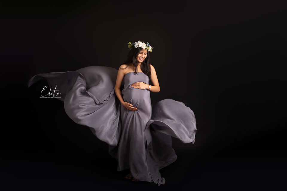 Fine art fabric tossing maternity photos in Pune