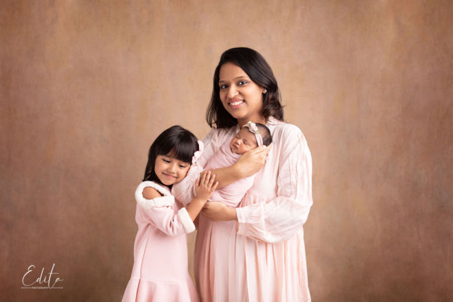 Mother with 2 daughters - newborn and big sister photo