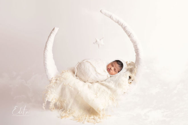 Indian Newborn baby in white moon setup