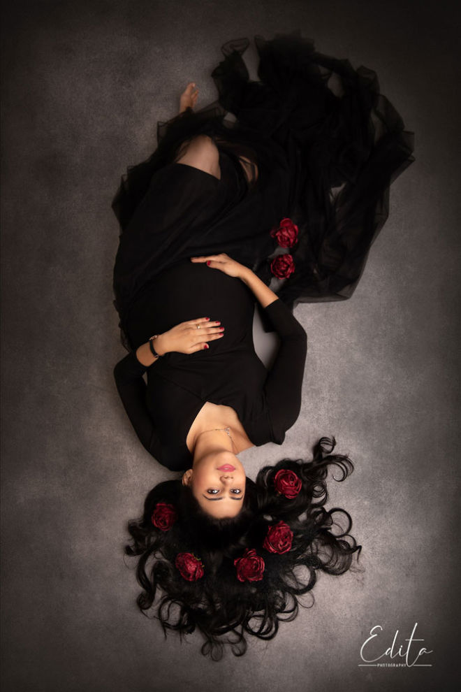 Maternity in black dress aerial photo