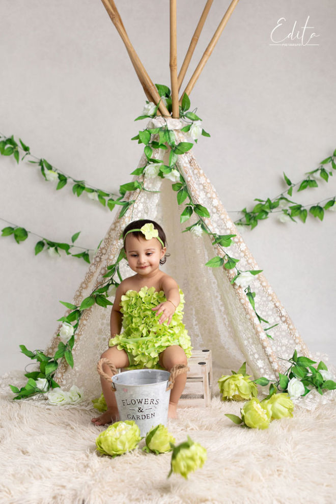 Toddler girl pic with white and green tent setup at photo studio Pune