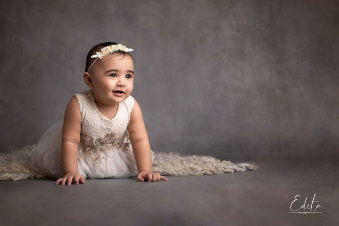 Fine art cute baby girl photos in neutral grey and white colors in Pune