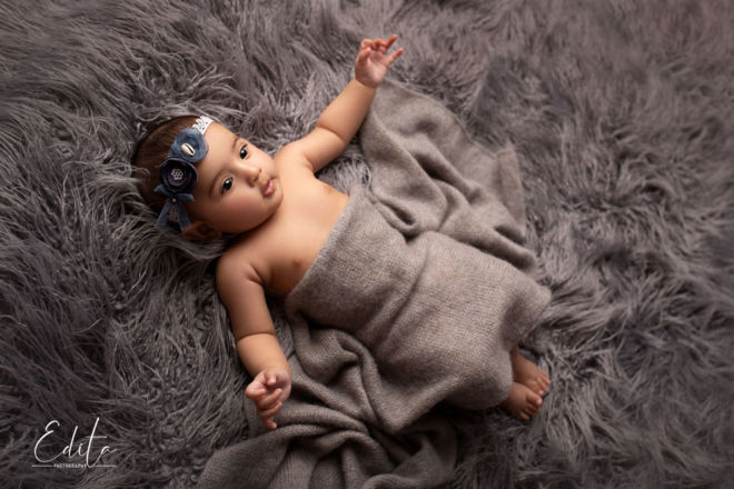 4 month baby girl on neutral grey fur