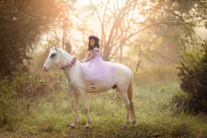 Children photo shoot - girl on white horse in the park at sunset time in Pune