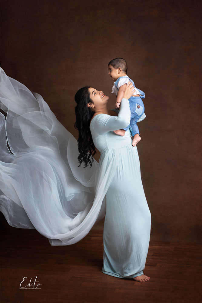Mother in beautiful gown with her baby boy