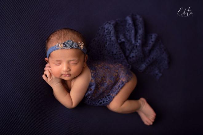 Baby newborn girl in blue