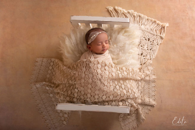 Vintage style newborn girl tiny bed setup in beige