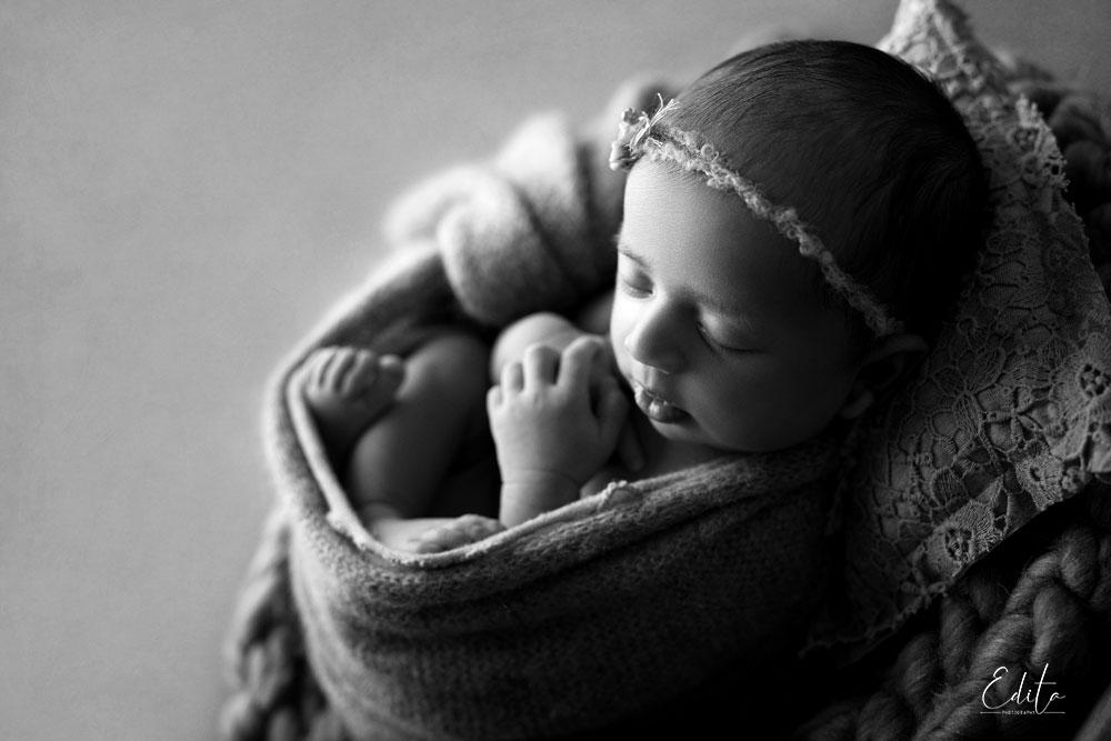 Dramatic light newborn baby photo in black and white