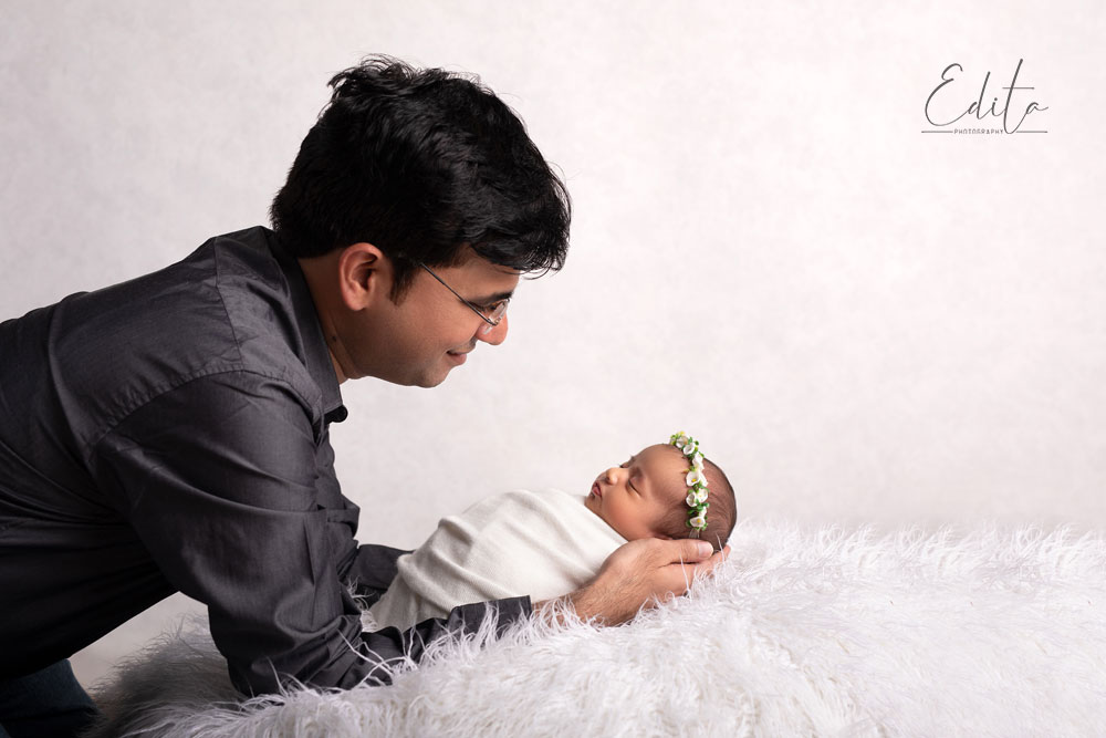 Dad is holding newborn baby