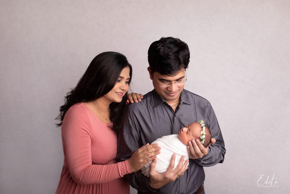 Newborn baby photo with family
