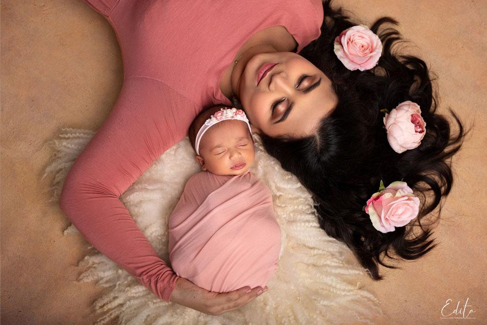 Aerial mom and newborn girl photo