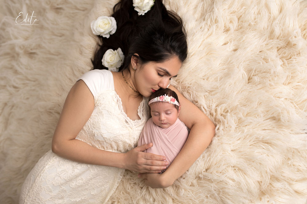 Aerial mom in white gown and newborn baby girl photography