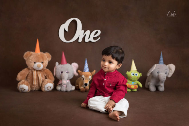 1 year old indian baby with soft toys photo
