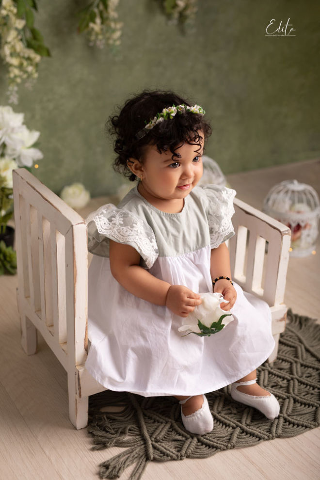 Indian baby girl in white and green dress