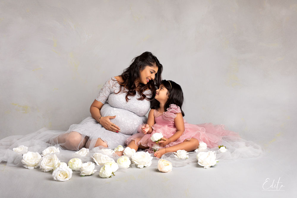 Maternity photo shoot, mother with her 4 year old daughter